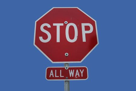 All directions stop sign isolated on blue photo