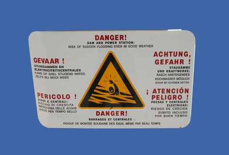 multilingual: multilingual danger dam sign in English French and German Stock Photo
