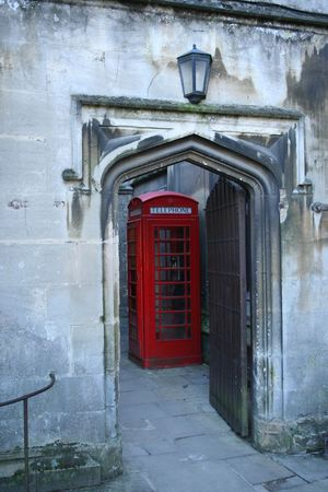 archway: Red british phone box through archway Oxford