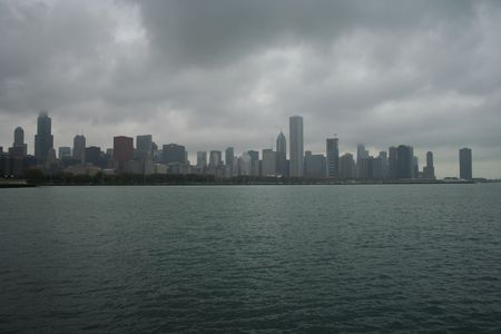 aon: Chicago skyline and lake michigan on an overcast day