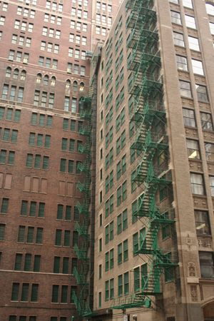 escapes: green painted fire escapes on side of old skyscraper