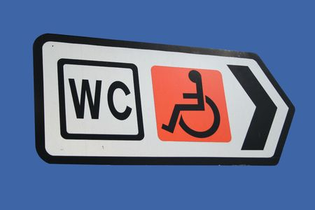 Disabled toilets sign with arrow isolated on blue photo