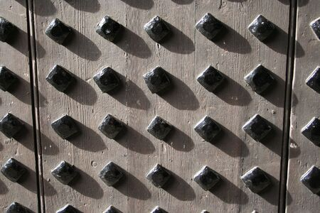 studs: wooden door with metal studs background