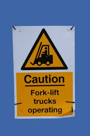 Forklift truck warning sign isolated on blue photo