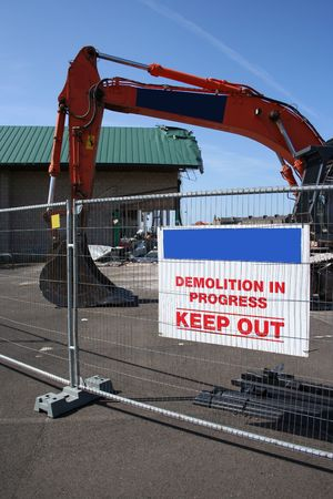 heavy machinery: demolition site with heavy machinery and sign Stock Photo