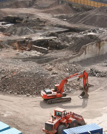 heavy machinery: aerial view of demolition site with heavy machinery