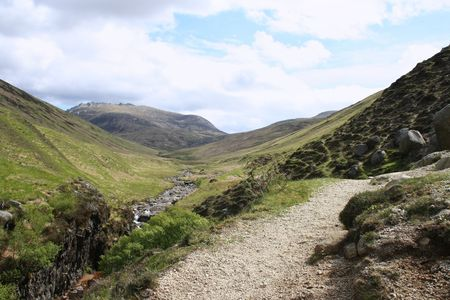 walking path leading to mountains Isle of Arran Scotland photo