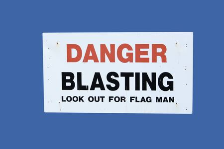 danger blasting sign isolated on blue photo
