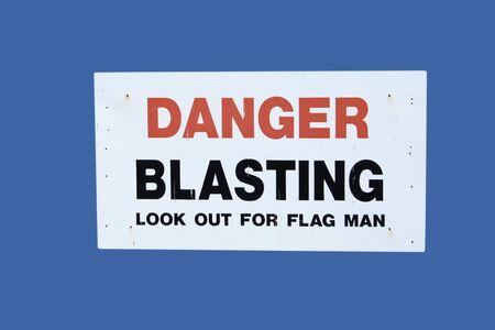 blasting: danger blasting sign isolated on blue