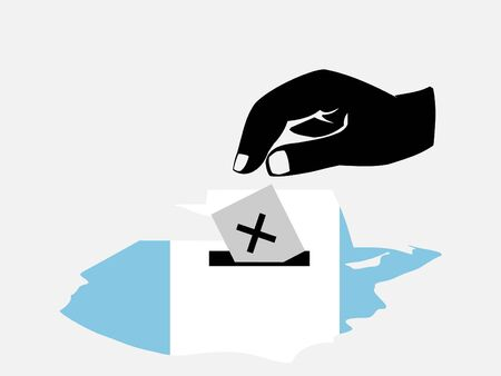 guatemalan: hand voting with ballot paper in Guatemalan election  Stock Photo