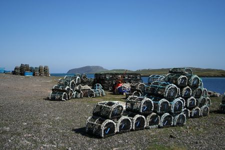 lobster pots: Piles of lobster pots stacked in groups near shore Stock Photo