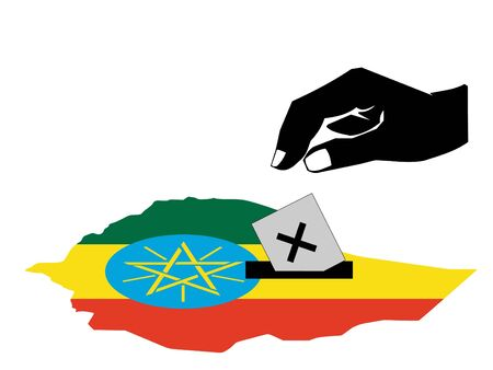 hand voting with ballot paper in Ethiopia election  photo