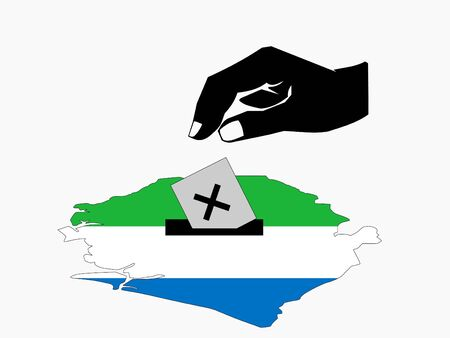 hand voting with ballot paper in Sierra Leone election  photo
