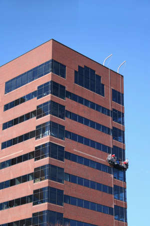 window cleaners at work on tall building Stock Photo - 1281429