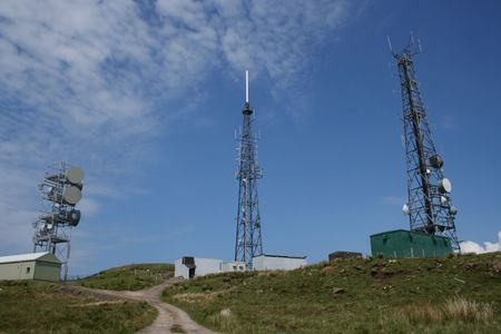 transmitting: three communication towers with assorted transmitting devices Stock Photo
