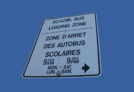 bilingual: bilingual school loading zone sign