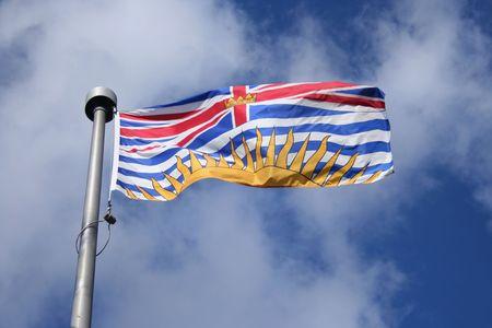 british  columbia: Flag of British Columbia against blue sky