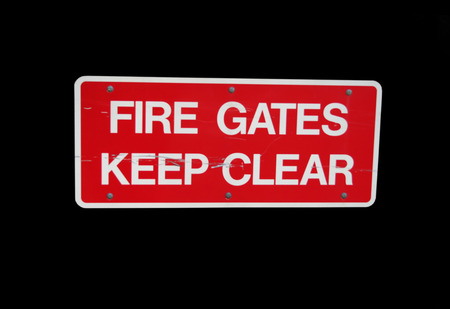 fire gates keep clear sign on black photo