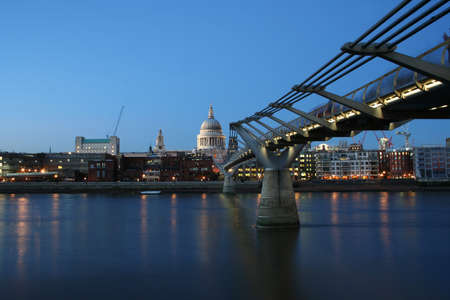 St Pauls cathedral and Millennium bridge, London at night photo