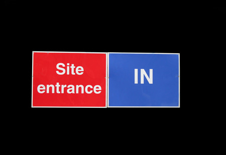 Site entrance in sign isolated on black