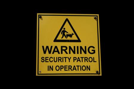 Security patrol sign man with guard dog photo