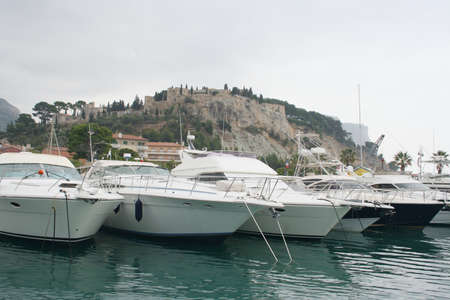 yachts moored in small french mediterranean village of Cassis photo