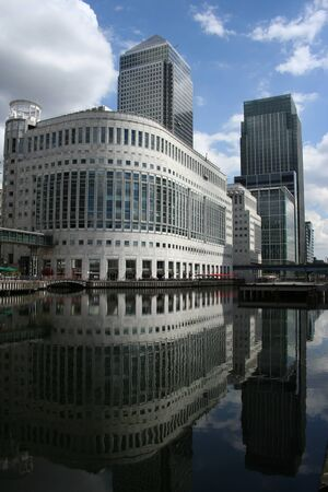 modern skyline of London Docklands reflected in water Stock Photo