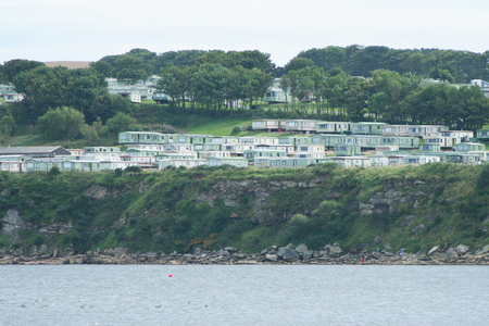 mobile home park by coast with cliffs