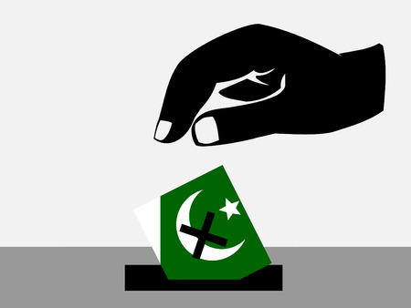 Hand voting with ballot paper in Pakistani election photo