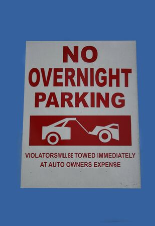 overnight: no overnight parking sign with tow truck and car symbol
