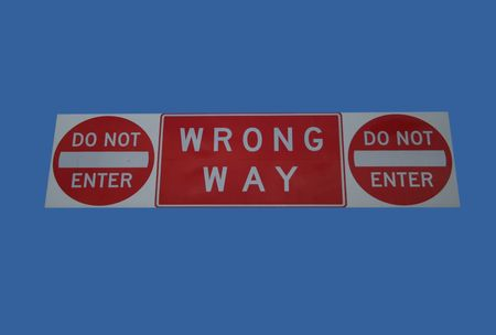 wrong way sign: do not enter wrong way sign isolated on blue