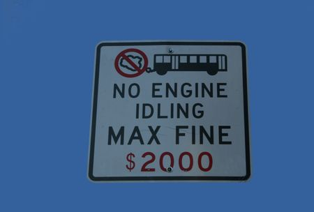 cease:  No parked idling sign with warning of fine
