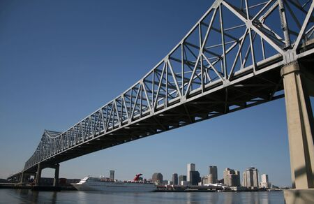 crescent city connection bridge with New Orleans skyline