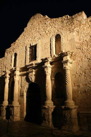 front facade of Alamo San Antonio illuminated at night photo