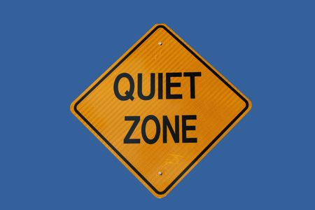 silent: Quiet zone sign isolated on blue Stock Photo
