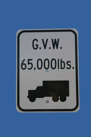 Truck weight limit sign 65,000 pounds isolated on blue photo