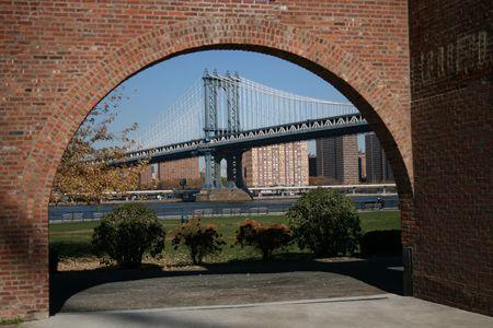 manhattan bridge and East River viewed through brick arch Stock Photo - 2527763