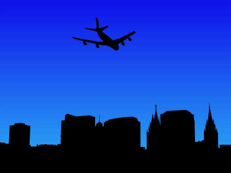 salt lake city: four engine plane flying over Salt Lake city skyline
