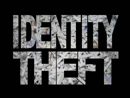 id theft: Identity theft text with shredded paper background