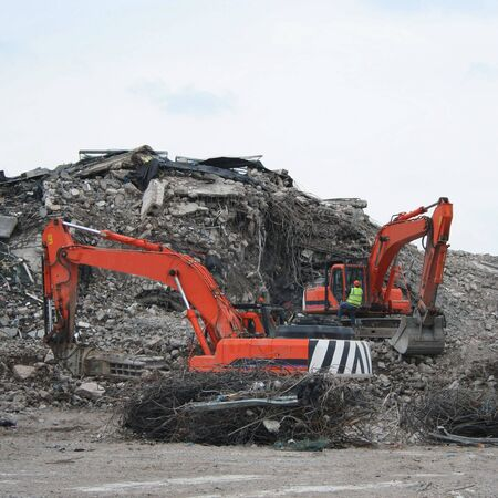 Demolition site with heavy machinery photo
