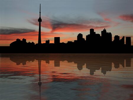 Toronto skyline at sunset reflected in water photo