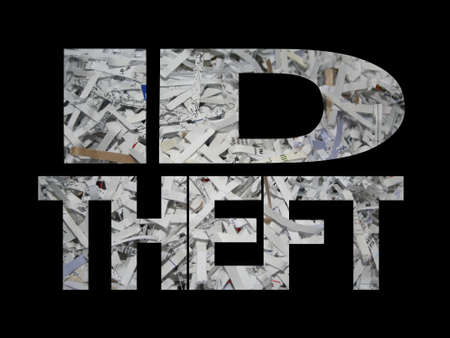 id theft: ID Theft text with white shredded paper background Stock Photo