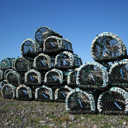 lobster pot: Piles of lobster pots stacked in groups Stock Photo