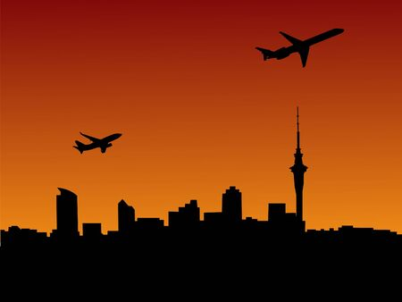 departing: two planes departing Auckland at sunset