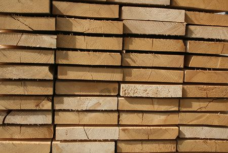 sawn: Stack of sawn wood for construction background Stock Photo