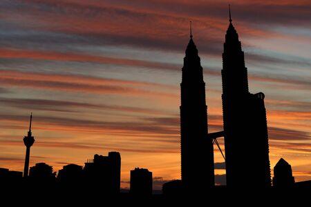 Kuala Lumpur skyline with Towers at sunset illustration