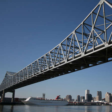 crescent city connection bridge with New Orleans skyline photo