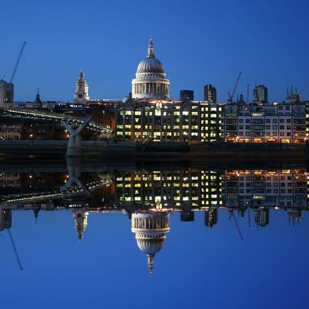 St Pauls cathedral and Millennium bridge, London reflected at dusk