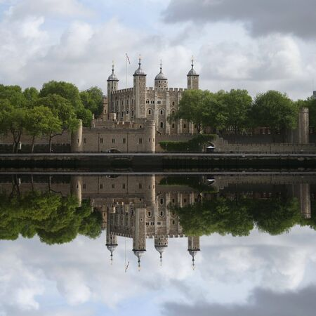 Tower of London reflected in River Thames