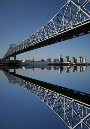 crescent city connection bridge and New Orleans skyline reflected